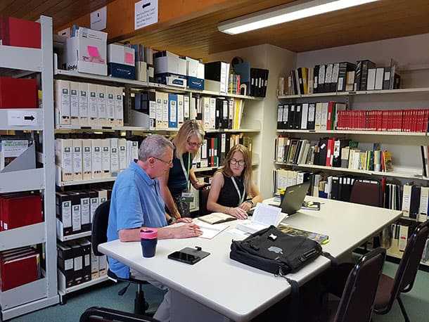 (L-R: Christopher Tower Reference Library volunteer Patrick Keane, New Forest Knowledge Digitisation Officer Karen Clarke and New Forest Knowledge Project Officer Dr Katharine Walker working in the Library)