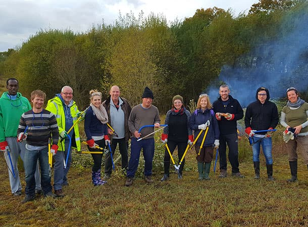 Habitats - Ordnance Survey staff members at a corporate volunteering day near Winsor in the New Forest.